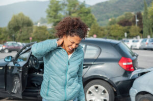 Hispanic woman in car accident injured neck